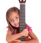 Girl hugging her guitar